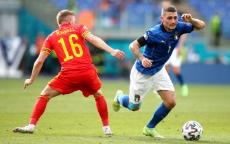 Wales' Joe Morrell (left) and Italy's Marco Verratti battle for the ball during the UEFA Euro 2020 Group A match at the Stadio Olimpico, Rome. Picture date: Sunday June 20, 2021.