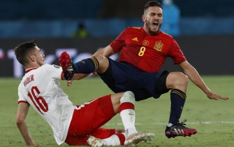 epa09286972 Jakub Moder (L) of Poland fouls Koke of Spain during the UEFA EURO 2020 group E preliminary round soccer match between Spain and Poland in Seville, Spain, 19 June 2021.  EPA/Julio Munoz / POOL (RESTRICTIONS: For editorial news reporting purposes only. Images must appear as still images and must not emulate match action video footage. Photographs published in online publications shall have an interval of at least 20 seconds between the posting.)