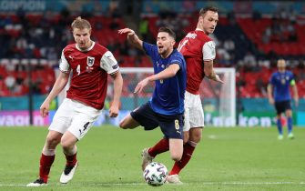Austria's forward Marko Arnautovic (R) fouls Italy's midfielder Jorginho (C) during the UEFA EURO 2020 round of 16 football match between Italy and Austria at Wembley Stadium in London on June 26, 2021. (Photo by Catherine Ivill / POOL / AFP) (Photo by CATHERINE IVILL/POOL/AFP via Getty Images)