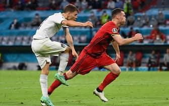 02 July 2021, Bavaria, Munich: Football: European Championship, Belgium - Italy, final round, quarter-final in the EM-Arena Munich. Italy's Nicolo Barella (l) scores the goal for 0:1. Photo: Federico Gambarini/dpa