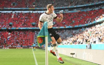 epa09285996 Robin Gosens of Germany celebrates after scoring a goal that was later disallowed during the UEFA EURO 2020 group F preliminary round soccer match between Portugal and Germany in Munich, Germany, 19 June 2021.  EPA/Christof Stache / POOL (RESTRICTIONS: For editorial news reporting purposes only. Images must appear as still images and must not emulate match action video footage. Photographs published in online publications shall have an interval of at least 20 seconds between the posting.)