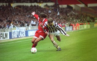 An Ascoli player holds off Notts County's Andy Legg (r) during the Anglo-Italian Cup final at Wembley. Notts County won the match 2-1.   (Photo by Derek Cox - PA Images/PA Images via Getty Images)