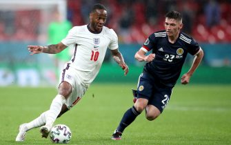 England's Raheem Sterling (left) and Scotland's Billy Gilmour battle for the ball during the UEFA Euro 2020 Group D match at Wembley Stadium, London. Picture date: Friday June 18, 2021.