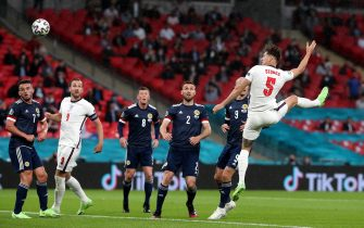 England's John Stones (right) has a header at goal during the UEFA Euro 2020 Group D match at Wembley Stadium, London. Picture date: Friday June 18, 2021.
