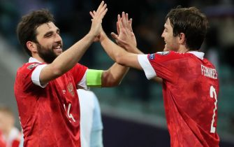 SOCHI, RUSSIA - MARCH 27, 2021: Russia's Georgy Dzhikiya (L) and Mario Fernandes celebrate their team's victory in the 2022 FIFA World Cup Group H Round 2 qualifying match between Russia and Slovenia at Fisht Stadium. Dmitry Feoktistov/TASS/Sipa USA