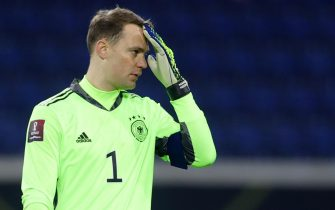 epa09097615 Germany's goalkeeper Manuel Neuer reacts during the FIFA World Cup 2022 qualifying soccer match between Germany and Iceland in Duisburg, Germany, 25 March 2021.  EPA/Friedemann Vogel
