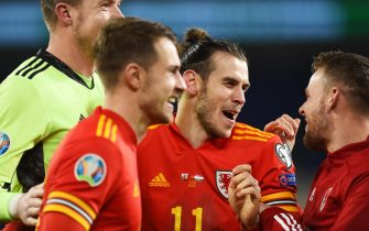 epa08010089 (from left) Goalkeeper Wayne Hennessey, Aaron Ramsey, Gareth Bale and Chris Gunter of Wales celebrate after the UEFA EURO 2020 Group E qualification match between Wales and Hungary in Cardiff, Wales, Britain, 19 November 2019. Wales won 2-0.  EPA/PETER POWELL