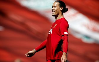 epa08540297 Liverpool's Virgil van Dijk smiles prior to the English Premier League soccer match between Liverpool FC and Burnley FC in Liverpool, Britain, 11 July 2020.  EPA/Phil Noble/NMC/Pool EDITORIAL USE ONLY. No use with unauthorized audio, video, data, fixture lists, club/league logos or 'live' services. Online in-match use limited to 120 images, no video emulation. No use in betting, games or single club/league/player publications.