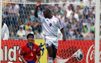 30 May 2001:  Nicolas Anelka of France reacts after scoring the 3rd goal for France as Song Chong Gug is dejected at the match between France and Korea Republic during the 2001 FIFA Confederations Cup at the Daegu World Cup Stadium, Daego City, Korea Republic. France won 5-0. DIGITAL IMAGE: X Mandatory Credit: Stanley Chou/ALLSPORT