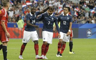 PARIS, FRANCE - JUNE 07: Nabil Fekir #7 of France celebrate his goal with Paul-Georges Ntep #24 and Dimitri Payet #12 during the International Friendly games between France and Belgium at Stade de France on june 7, 2015 in Paris, France. (Photo by Xavier Laine/Getty Images)