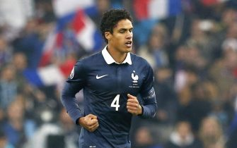 epa04494929 Raphael Varane of France celebrates after scoring a goal against Sweden during a friendly soccer match at the Velodrome stadium, in Marseille, France, 18 November 2014.  EPA/GUILLAUME HORCAJUELO