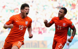 FORTALEZA, BRAZIL - JUNE 29: Klaas-Jan Huntelaar of the Netherlands (L) celebrates scoring his team's second goal on a penalty kick in stoppage time with Memphis Depay during the 2014 FIFA World Cup Brazil Round of 16 match between Netherlands and Mexico at Castelao on June 29, 2014 in Fortaleza, Brazil.  (Photo by Dean Mouhtaropoulos/Getty Images)