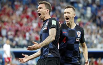 epa06856144 Mario Mandzukic of Croatia reacts with Ivan Perisic of Croatia (R) after scoring the 1-1 the FIFA World Cup 2018 round of 16 soccer match between Croatia and Denmark in Nizhny Novgorod, Russia, 01 July 2018.