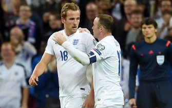 epa04920878 England's Harry Kane (L) with Wayne Rooney (R) after Kane scored the 1-0 goal during the UEFA EURO 2016 Group E qualification match between England and Switzerland, at Wembley Stadium in London, Britain, 08 September 2015.  EPA/ANDY RAIN