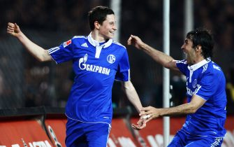 HAMBURG, GERMANY - APRIL 01:  Julian Draxler of Schalke celebrates with his team mate Raul after scoring his team's second goal during the Bundesliga match between FC St. Pauli and FC Schalke 04 at Millerntor Stadium on April 1, 2011 in Hamburg, Germany.  (Photo by Joern Pollex/Bongarts/Getty Images)