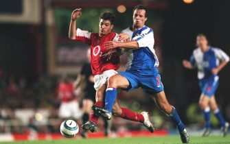 LONDON, ENGLAND - AUGUST 25: Cesc Fabregas of Arsenal is chellenged by Lucas Neill of Blackburn during the Premier League match between Arsenal and Blackburn Rovers on August 25, 2004 in London, England. (Photo by David Price/Arsenal FC via Getty Images)