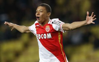 """Monaco's French forward Kylian Mbappe Lottin celebrates after scoring a goal during the French L1 football match Monaco (ASM) vs Troyes (ESTAC) on February 20, 2016 at the """"Louis II Stadium"""" in Monaco.  AFP PHOTO / VALERY HACHE / AFP / VALERY HACHE        (Photo credit should read VALERY HACHE/AFP via Getty Images)"""