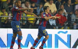 FC Barcelona's Bojan Krkic (R) celebrates his goal with French Thierry Henry during their Spanish league football match against Villarreal at Madrigal Stadium in Valencia 20 October 2007. AFP PHOTO/Diego Tuson (Photo credit should read DIEGO TUSON/AFP via Getty Images)
