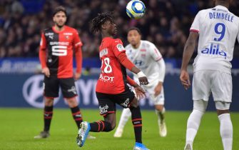 Rennes' French midfielder Eduardo Camavinga controls the ball (C) during the French L1 football match between Olympique Lyonnais and Stade Rennais Football Club at the Groupama stadium in Decines-Charpieu near Lyon, central eastern France on December 15, 2019. (Photo by ROMAIN LAFABREGUE / AFP) (Photo by ROMAIN LAFABREGUE/AFP via Getty Images)