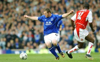 LIVERPOOL - 19 OCTOBER:  Wayne Rooney of Everton takes on Lauren of Arsenal during the FA Barclaycard Premiership match between Everton and Arsenal at Goodison Park in Liverpool on October 19, 2002. Everton won 2-1. (photo by Shaun Botterill/Getty Images.)