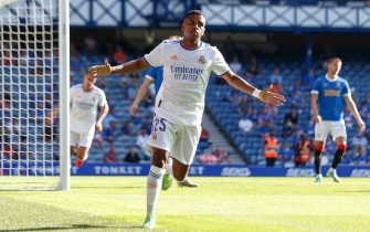 epa09365503 Rodrygo of Real Madrid celebrates after scoring the 1-0 lead during the pre-season friendly test soccer match between Glasgow Rangers and Real Madrid at Ibrox Stadium in Glasgow, Britain, 25 July 2021.  EPA/Robert Perry