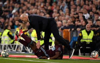Real Madrid's French coach Zinedine Zidane (up) collides with Celta Vigo's Ghanaian defender Joseph Aidoo (down) during the Spanish league football match between Real Madrid CF and RC Celta de Vigo at the Santiago Bernabeu stadium in Madrid on February 16, 2020. (Photo by PIERRE-PHILIPPE MARCOU / AFP) (Photo by PIERRE-PHILIPPE MARCOU/AFP via Getty Images)
