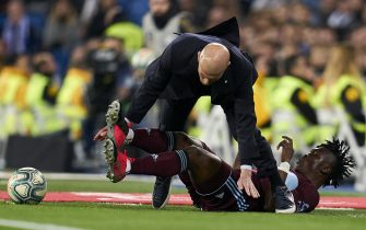 MADRID, SPAIN - FEBRUARY 16: Zinedine Zidane, Manager of Real Madrid CF is hitted by Aidoo of RC Celta de Vigo during the Liga match between Real Madrid CF and RC Celta de Vigo at Estadio Santiago Bernabeu on February 16, 2020 in Madrid, Spain. (Photo by Diego Souto/Quality Sport Images/Getty Images)
