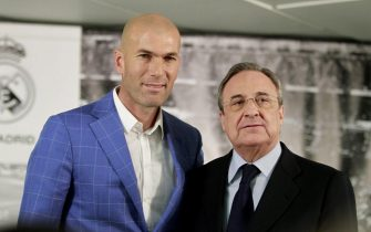 epa05087941 Real Madrid's president Florentino Perez (R) and French head coach Zinedine Zidane (L) during his presentation as new coach of the team during an act held in Santiago Bernabeu stadium in Madrid, Spain on 04 January 2016. Real Madrid and France icon Zinedine Zidane is taking over the job as Real Madrid's head coach from sacked Benitez, the Spanish first division soccer club announced on 04 January 2016.  EPA/VICTOR LERENA