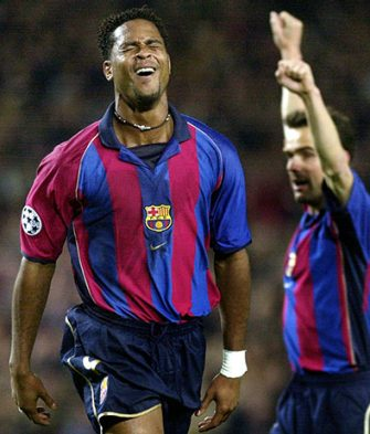 B16 - 20020220 - BARCELONA, CATALONIA, SPAIN : Barcelona's dutch striker Patrick Kluivert (L) jubilates after scoring against AS Roma during their Champions League group B soccer match at Nou Camp stadium in Barcelona, Wednesday 20 February 2002. The match ended 1-1 draw. Player at right is unidentified.  EPA PHOTO   EFE/ANDREU DALMAU/sj/mr