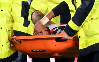 Paris Saint-Germain's Brazilian forward Neymar (C) is evacuated on a stretcher during the French L1 football match between Paris Saint-Germain (PSG) and Lyon (OL), on December 13, 2020 at the Parc des Princes stadium in Paris. (Photo by FRANCK FIFE / AFP) (Photo by FRANCK FIFE/AFP via Getty Images)