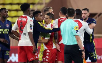 Players fight a the end of the L1 football match between Monaco (ASM) and Lyon (OL) at The Louis II Stadium, in Monaco on May 2, 2021. (Photo by Valery HACHE / AFP) (Photo by VALERY HACHE/AFP via Getty Images)