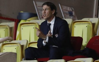 epa09174574 Lyon's head coach Rudi Garcia sits in the stands during the French Ligue 1 soccer match between AS Monaco and Olympique Lyonnais at the Louis II stadium, in Monaco, 02 May 2021.  EPA/SEBASTIEN NOGIER