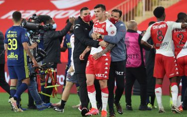 Players argue a the end of the L1 football match between Monaco (ASM) and Lyon (OL) at The Louis II Stadium, in Monaco on May 2, 2021. (Photo by Valery HACHE / AFP) (Photo by VALERY HACHE/AFP via Getty Images)