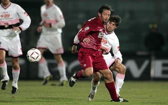 ©Stefano D'Errico / LaPresse06-03-2005 LivornoSport CalcioLivorno Palermo campionato serie A 2004 2005Nella foto CLAUDIO GRAUSO CONTRASTATO DA FRANCO BRIENZA