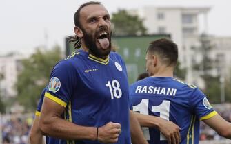 epa07825274 Kosovo's Vedat Muriqi celebrates scoring during the UEFA EURO 2020 Group A qualifying soccer match between Kosovo and Czech Republic in Pristina, Kosovo, 07 September 2019.  EPA/VALDRIN XHEMAJ