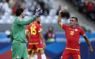 epa07833524 Andorra's goalkeeper Josep Gomes (L) celebrates with Andorra's Chus Rubio (R) after saving a penalty shot during the UEFA EURO 2020 qualifying soccer match between France and Andorra in Saint-Denis, near Paris, France, 10 September 2019.  EPA/YOAN VALAT