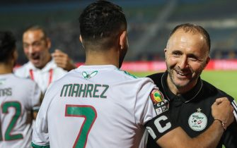 07 July 2019, Egypt, Cairo: Algeria's national team coach Djamel Belmadi embraces Algeria's Riyad Mahrez after the final whistle of the 2019 Africa Cup of Nations round of 16 soccer match between Algeria and Guinea at the 30 June Stadium. Photo: Gehad Hamdy/dpa
