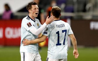 epa09103857 Ryan Fraser of Scotland celebrates with teammate Callum McGregor after scoring during the FIFA World Cup 2022 qualifying soccer match between Israel and Scotland in Tel Aviv, Israel, 28 March 2021.  EPA/Atef Safadi