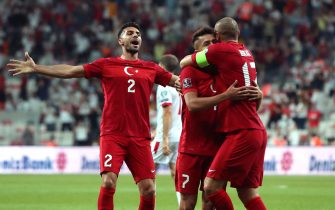 epa09441427 Turkey's Cengiz Under (C) celebrates with team mates Burak Yilmaz (R) and Zeki Celik (L) after scoring the 1-0 lead during the FIFA World Cup 2022 qualifying group G match between Turkey and Montenegro in Istanbul, Turkey 01 September 2021.  EPA/TOLGA BOZOGLU