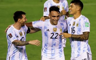 epa09444462 Argentina's Lautaro Martinez (C) celebrates with his teammates Lionel Messi (L) and Joaquin Correa (R) after scoring against Venezuela, during the Conmebol qualifiers for the Qatar 2022 World Cup between Venezuela and Argentina, in Caracas, Venezuela, 02 September 2021.  EPA/Miguel Gutierrez / POOL