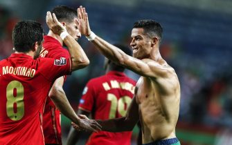 epa09441734 Cristiano Ronaldo (R) of Portugal celebrates after scoring a goal during the FIFA World Cup Qatar 2022 group A qualification soccer match between Portugal and Ireland held at Algarve stadium in Faro, Portugal, 01 September  2021.  EPA/ANTONIO COTRIM