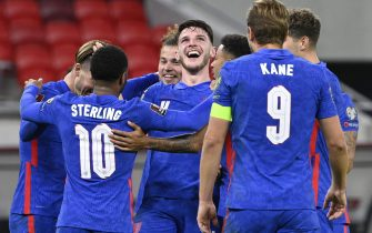 epa09444048 Declan Rice (C) of England celebrates with teammates after he scored his side's fourth goal during the FIFA World Cup Qatar 2022 qualifying Group I soccer match Hungary vs England at Puskas Ferenc Arena in Budapest, Hungary, 02 September 2021.  EPA/Zsolt Szigetvary HUNGARY OUT
