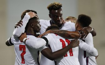 epa09515581 England's Buyako Saka (L), accompanied by teammates, reacts after scoring the second goal against Andorra during the FIFA World Cup 2022 qualifying soccer match between Andorra and England in Andorra la Vella, Andorra, 09 October 2021.  EPA/ALEJANDRO GARCIA