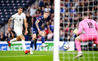 Scotland's Lyndon Dykes (second left) has a shot on goal during the FIFA World Cup Qualifying match at Hampden Park, Glasgow. Picture date: Saturday October 9, 2021.