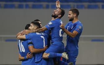 epa09515202 Players of Greece react after scoring during their FIFA World Cup 2022 Qualifying round - Group B soccer match between Georgia and Greece in Batumi, Georgia, 09 October 2021.  EPA/ZURAB KURTSIKIDZE