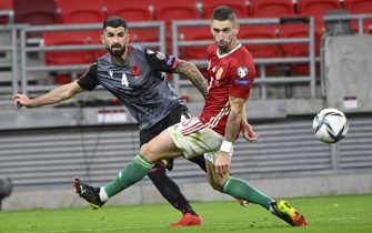 epa09515531 Zsolt Nagy (R) of Hungary in action against Elseid Hysaj of Albania during the FIFA World Cup 2022 Group I qualifying soccer match between Hungary and Albania at the Puskas Arena in Budapest, Hungary, 09 October 2021.  EPA/Zsolt Szigetvary HUNGARY OUT