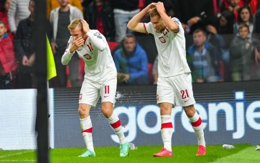 TIRANA, ALBANIA - OCTOBER 12: Karol Swiderki and Tymoteusz Puchacz of Poland being thrown with objects by Albania fans after a goal has been scored during the 2022 FIFA World Cup Qualifier match between Albania and Poland at  on October 12, 2021 in Tirana, Albania. (Photo by PressFocus/MB Media/Getty Images)