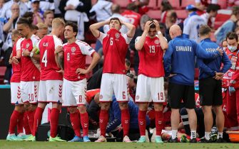 epa09266507 Players of Denmark react while their teammate Christian Eriksen receives medical treatment during the UEFA EURO 2020 group B preliminary round soccer match between Denmark and Finland in Copenhagen, Denmark, 12 June 2021. Eriksen collapsed on the pitch towards the end of the first half and received medical on the pitch before being stretchered off and rushed to a nearby hospital.  EPA/Friedemann Vogel / POOL (RESTRICTIONS: For editorial news reporting purposes only. Images must appear as still images and must not emulate match action video footage. Photographs published in online publications shall have an interval of at least 20 seconds between the posting.)