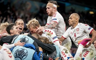 epa09292260 Danish players celebrate after winning the UEFA EURO 2020 group B preliminary round soccer match between Russia and Denmark in Copenhagen, Denmark, 21 June 2021.  EPA/Mads Claus Rasmussen  DENMARK OUT