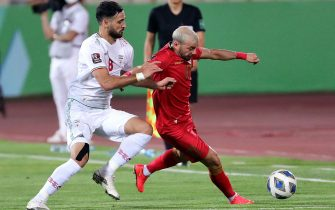 Iran's Ahmad Noorolahi (L) and Syria's Mahmoud al-Mawas view for the ball during the 2022 Qatar World Cup Asian Qualifiers football match between Iran and Syria, at the Azadi Stadium in Tehran, on September 2, 2021. (Photo by STRINGER / AFP) (Photo by STRINGER/AFP via Getty Images)